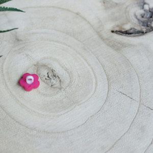 flower pink button